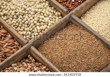 teff and other gluten free grains in a wooden rustic box