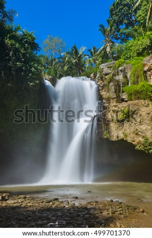 Tegenungan Waterfall on Bali island Indonesia - travel and nature background