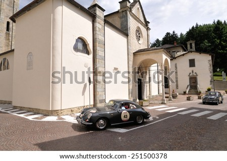 TEGLIO (SO), ITALY - JUNE 13: A gray Porsche 356 takes part to the Summer Marathon classic car race on June 13, 2014 in Teglio (SO). This car was built in 1960 - stock photo