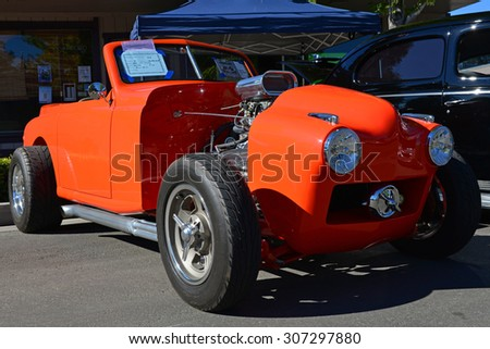 TEHACHAPI, CA - AUG 16, 2015: An unusual street rod appears at the Thunder on the Mountain Car & Truck Show, based on a 1951 Crosley in bright orange paint. - stock photo