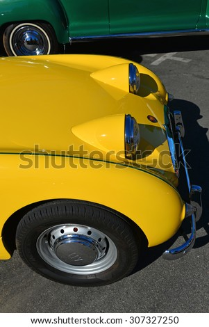 TEHACHAPI, CA - AUG 16, 2015: The Thunder on the Mountain Car & Truck Show is brightened by an immaculate bright yellow 1959 Austin Healey Sprite displayed by Jack Williams. - stock photo