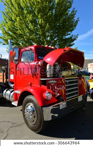 TEHACHAPI, CA - AUG 16, 2015: This 1959 GMC truck is definitely not your usual car show item. It made an appearance during the Thunder on the Mountain Car & Truck Show. - stock photo
