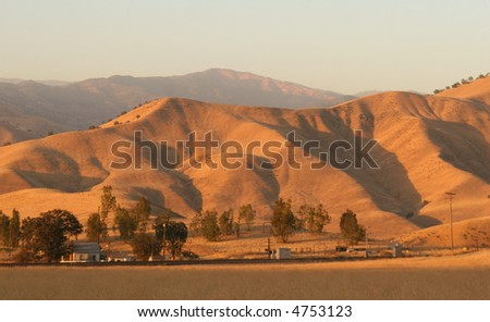 Tehachapi Mountains at sunset. - stock photo