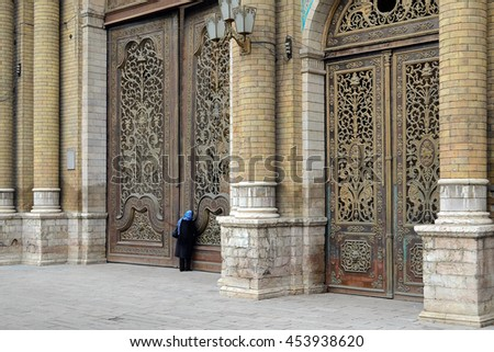 TEHRAN, IRAN - DECEMBER 30, 2012: National Garden old entrance gates. The National Garden is a famous historical and governmental compound.