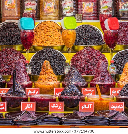 Tehran, Iran - November 30, 2015: Traditionally dried and processed sour plums, sour cherries and forest fruits for sale in Darband area of Tehran, Iran. - stock photo