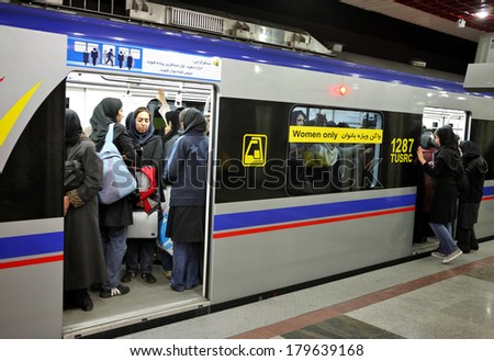 TEHRAN, IRAN - NOVEMBER 24, 2007:  Underground station in Tehran Metro has separate compartments  women only.  - stock photo