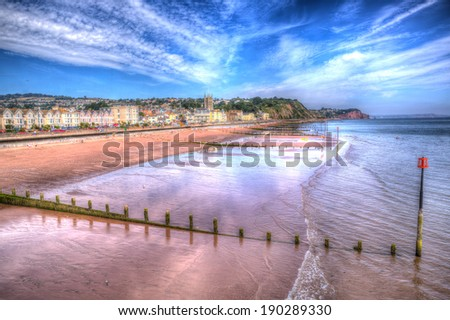 Teignmouth beach Devon England UK with blue sky and stunning clouds in HDR