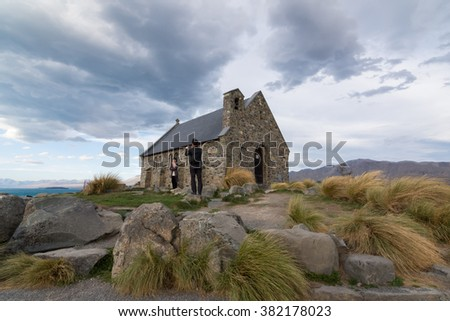 TEKAPO, NEW ZEALAND - FEBRUARY 26, 2016: Couple takes photo at the Church of the Good Shepherd.
