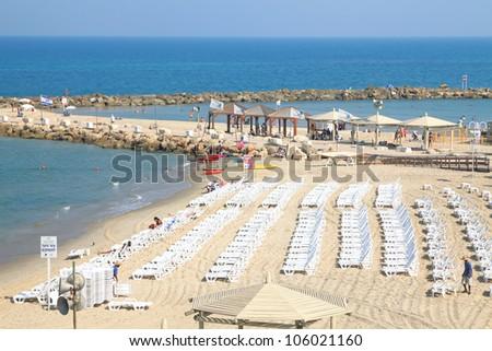 Tel-Aviv beach morning - a lot of not occupied beach chairs. Mediterranean sea, Israel - stock photo