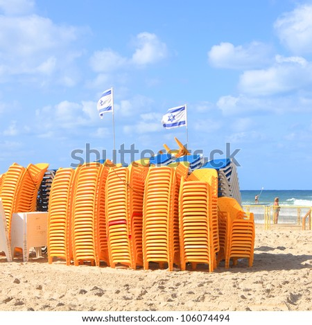 Tel-Aviv beach morning  - a lot of not occupied beach chairs. Mediterranean sea, Israel - stock photo