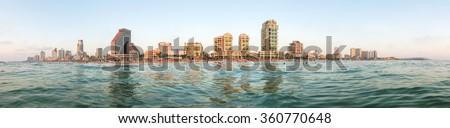 Tel Aviv city panoramic view from Mediterranean Sea.   - stock photo