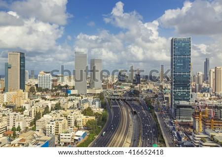Tel Aviv City Skyline And Ayalon Freeway At Cloudy Day - stock photo