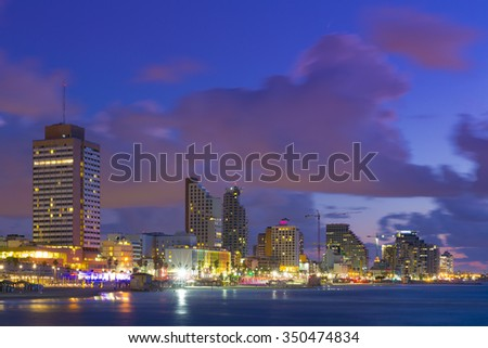 Tel Aviv Cityscape At Sunset - View From Sea To Beachfront  - stock photo