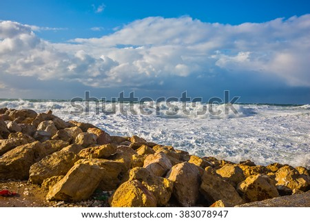 Tel Aviv in January. New Quay in the Old Jaffa in winter storm. Huge foaming waves of the Mediterranean beat against the shore