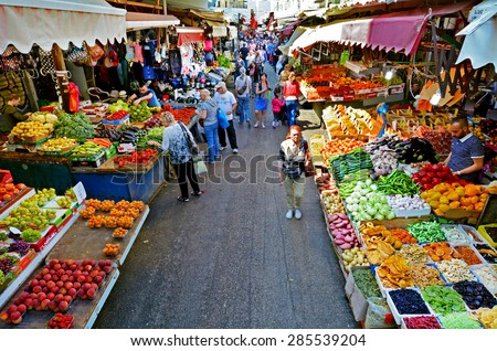 TEL AVIV, ISR - MAR 24 2015:Shoppers at Carmel Market Shuk HaCarmel in Tel Aviv, Israel.It's a very popular marketplace in Tel Aviv sells mostly food and home accessories goods. - stock photo