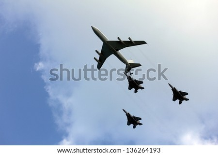 TEL AVIV, ISRAEL - APRIL  16: Israeli Air Force airplanes ( turboprop  and three jet fighters) imitating aerial refueling at parade in honor of Independence Day on April 16, 2013 in Tel Aviv, Israel