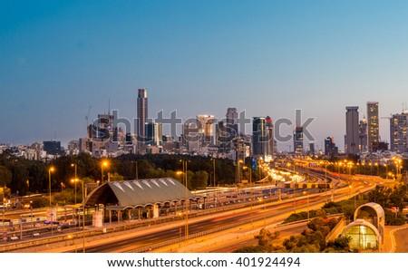 TEL AVIV, ISRAEL - APRIL 01, 2016 : Night view of traffic on Ayalon highway over Ramat Gun skyscrapers  in Tel Aviv, Israel.  - stock photo