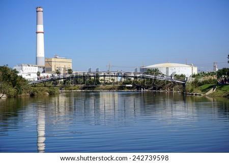 TEL AVIV, ISRAEL - CIRCA OCTOBER 2014 Power station and bridge on the Yarkon river                                - stock photo