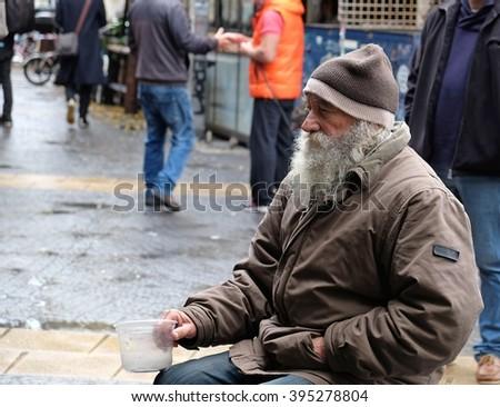 TEL-AVIV, ISRAEL - DECEMBER 18, 2015: Old beggar in Tel-Aviv. Israel - stock photo