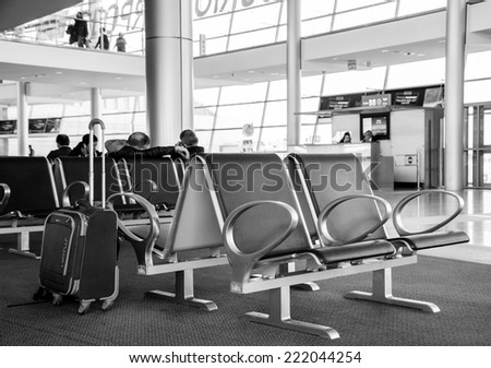 TEL AVIV, ISRAEL - FEBRUARY 13, 2014: Tourists and Israeli citizens waiting for their departures in the Ben Gurion International Airport. - stock photo