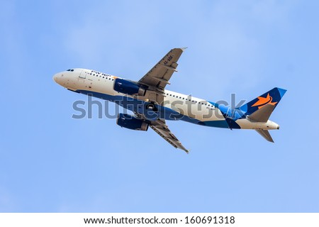 TEL AVIV, ISRAEL - JULY 12: Airbus A320  Israir Airlines  taking off from  the Ben Gurion International Airport  on July 12, 2013  in Tel Aviv, Israel. It seats 150 passengers. - stock photo