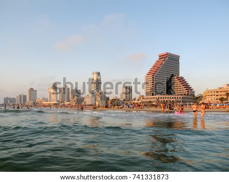 TEL AVIV/ ISRAEL - JULY 16, 2008: City beach panorama agains skyline background viewed from Mediterranean Sea on July 16, 2008 in Tel Aviv.