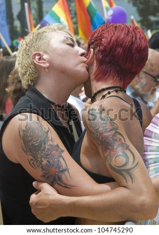 TEL AVIV , ISRAEL - JUNE 08  : An unidentified Israeli lesbians kissing during the opening of the annual Gay pride in Tel Aviv on June 08 2012