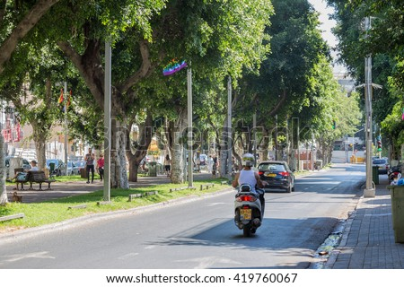 TEL AVIV,  ISRAEL-JUNE 13, 2015:famed Rothschild Boulevard. People walk down the avenue