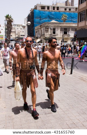 Tel Aviv, Israel, June 03, 2016: Members of the traditional yearly pride parade surrounded by other people in Tel Aviv, Israel