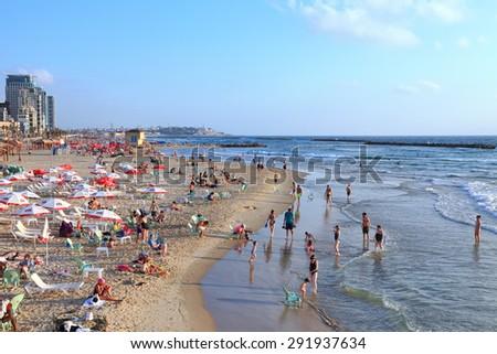 TEL AVIV, ISRAEL - JUNE 19, 2015 : Tel-Aviv beach and people enjoying the evening on the eve of the day off (Mediterranean sea. Israel) - stock photo