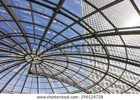 TEL AVIV, ISRAEL - MAY 22, 2014 : Triangle tower building over glass dome of Azrieli shopping mall in Tel Aviv, Israel on May 22, 2014. Azrieli shopping center is the biggest in Israel