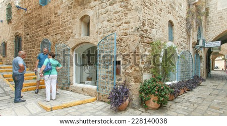 Tel Aviv, ISRAEL - November 2, 2014 : Typical view of Jaffa's narrow old alley with tourists. Jaffa is part of Tel Aviv, Located to the south and known as an ancient port city from the bronze age.