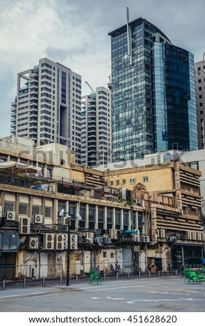Tel Aviv, Israel - October 19, 2015. Old and modern buildins seen from Givon Square in Tel Aviv - stock photo