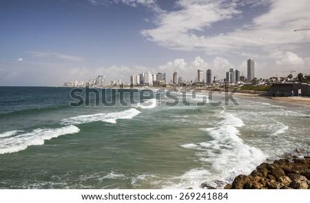 TEL AVIV, ISRAEL - OCTOBER 19, 2014: Skyline, beaches and Mediterranean Sea surf of southern Tel Aviv. - stock photo