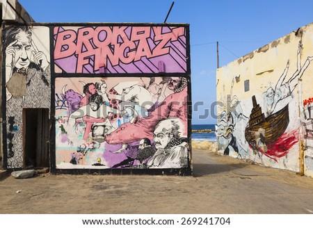 TEL AVIV, ISRAEL - OCTOBER 19, 2014: Street art (graffiti) by Broken Fingaz near wreck of Dolphinarium Discotheque.  - stock photo
