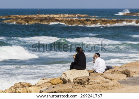 TEL AVIV, ISRAEL - OCTOBER 19, 2014: Unidentified local couple at the seashore enjoys the view.