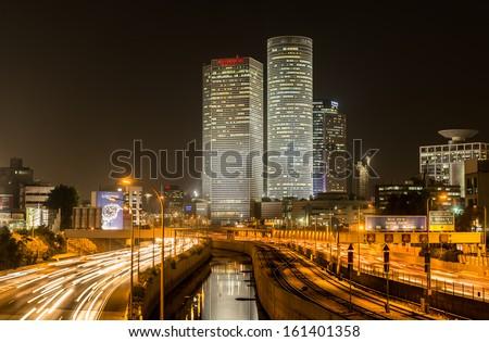 Tel Aviv, Israel.   4th Nov 2013 Night view of Azrieli buildings and Ayalon road from Arlozorov bridge in Tel Aviv, Israel - stock photo