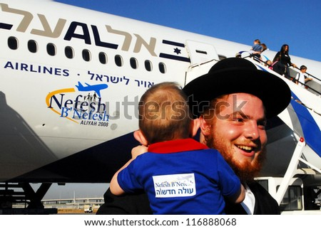 TEL AVIV - JULY 22: New Jewish immigrants making Aliya in Ben Gurion Airport on July 22 2008.It's the immigration of Jews to the Land of Israel since the Babylonian exile. - stock photo