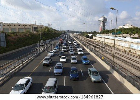 TEL AVIV - JUN 28: The Ayalon highway at the peak of the afternoon rush hour, the road is jammed with cars of people on their way home at the end of a work day on June 28 2012 in Tel Aviv, Israel.