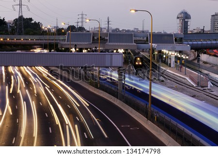 TEL AVIV - JUNE 28th: Evening rush hour time at the Ayalon highway and Savidor train station. A train is about to depart, and people are waiting on the platform for their train to arrive, on June 28th, 2011, in Ayalon, Israel. - stock photo