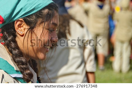 TEL AVIV - MAY 9, 2015: Unidentified Israel girl Scouts youth leader aged 16-17 celebrating in a yearly graduation passage ceremony in a Tel Aviv suburb