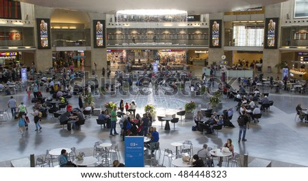 TEL AVIV-SEPT 11 2016:Passengers In Terminal 3 of Ben Gurion Airport, Israel.It considered to be among best airports in the Middle East due to its passenger experience and its high level of security.