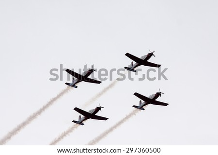 TEL NOF, ISRAEL -APRIL 16: Four army training airplanes performing an exhibition exercise during the Israeli Independence day show on April 16, 2013 in Tel Nof, Israel.