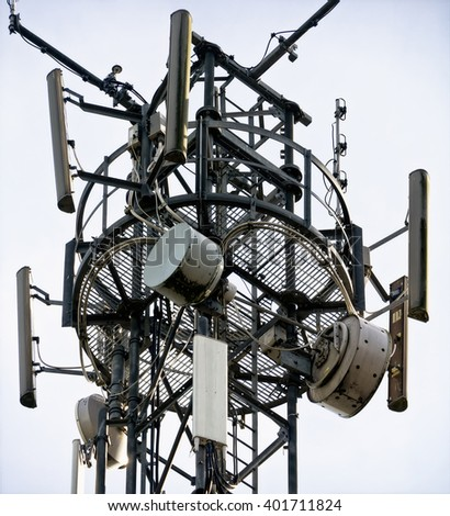 Telecom/cellphone mast; details of telecommunications or cell-phone tower - stock photo