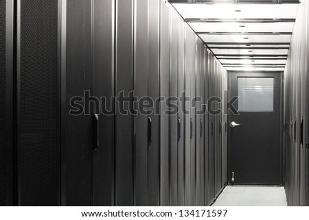 Telecom equipment in racks in a sealed corridor.