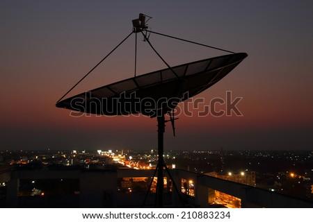 Telecom satellite dish over Twilight background - stock photo