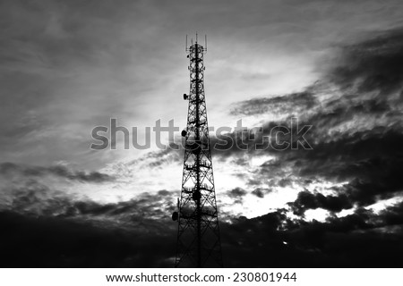 Telecom tower on sky & clouds background - monochrome effect - stock photo
