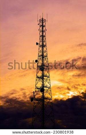 Telecom tower silhouette  in twilight sky background