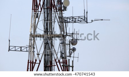 Telecom tower with various wireless equipment installed on steel elements