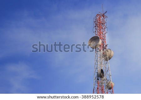 Telecommunication antenna for radio, television and telephone with blue sky.